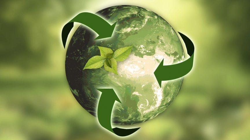 Zielona planeta z trzema zielonymi strzałkami